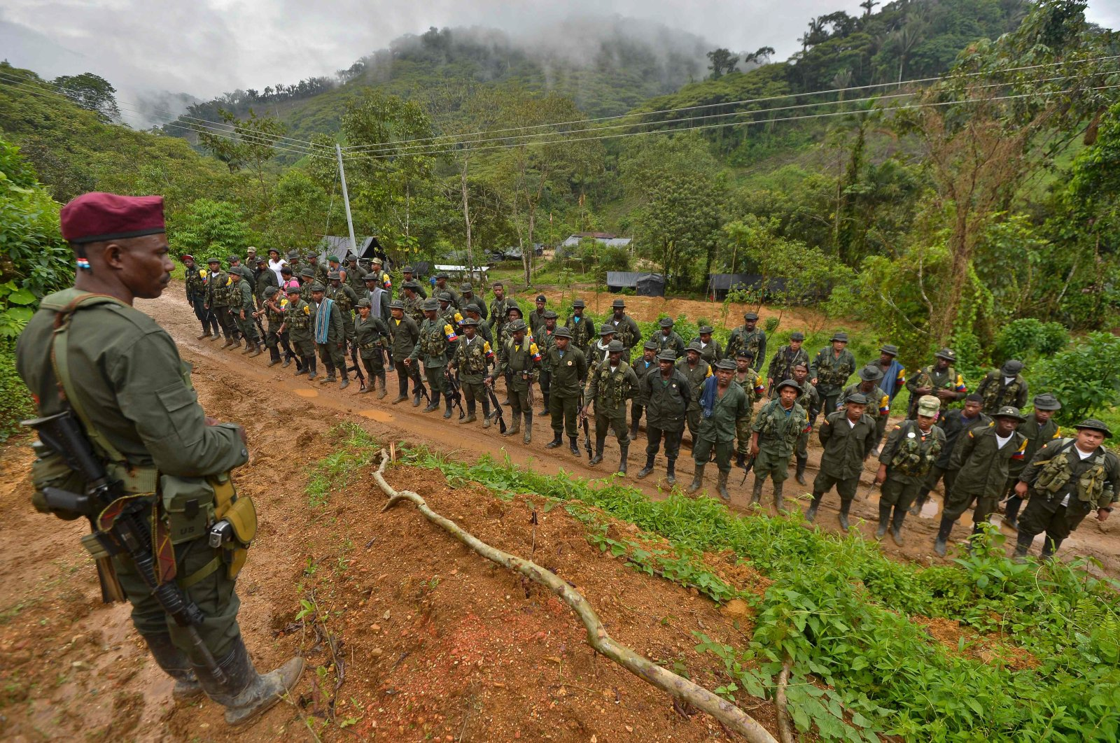 """Members of the Revolutionary Armed Forces of Colombia (FARC) guerrillas are seen at the """"Alfonso Artiaga"""" Front 29 FARC encampment in a rural area of Policarpa, department of Narino, Colombia, Jan. 17, 2017. (AFP Photo)"""