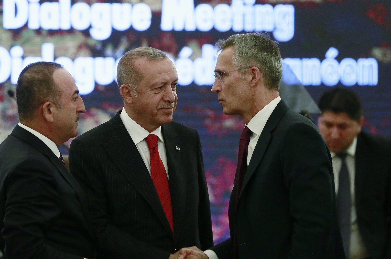 President Recep Tayyip Erdoğan (C) and Foreign Minister Mevlüt Çavuşogğu (L) speak with NATO Secretary General Jens Stoltenberg during a meeting of NATO's Mediterranean dialogue, Ankara, May 6, 2019. (AP Photo)