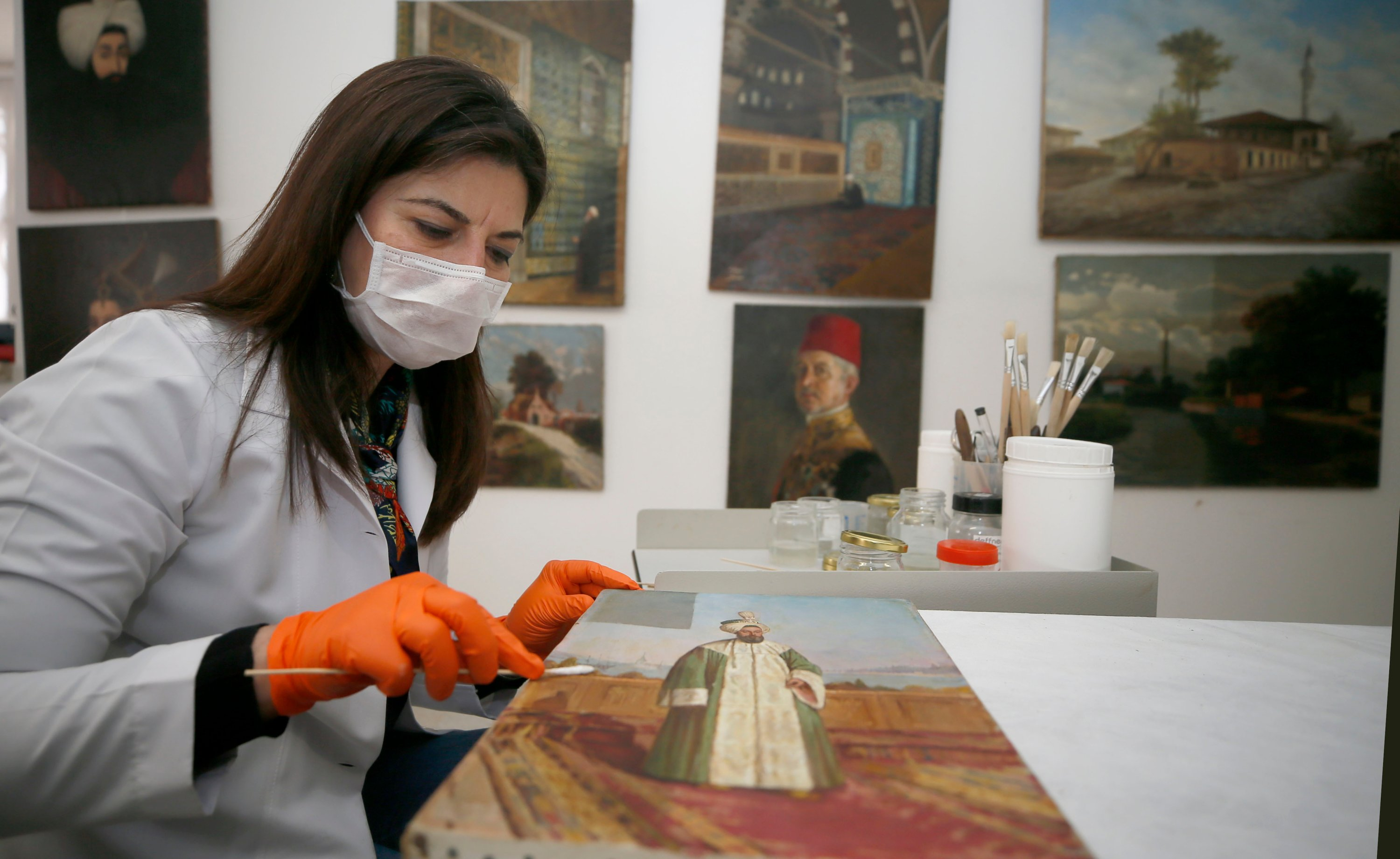 The restoration of the paintings is carried out in the Painting Museum and Yıldız Şale workshops. (AA Photo)