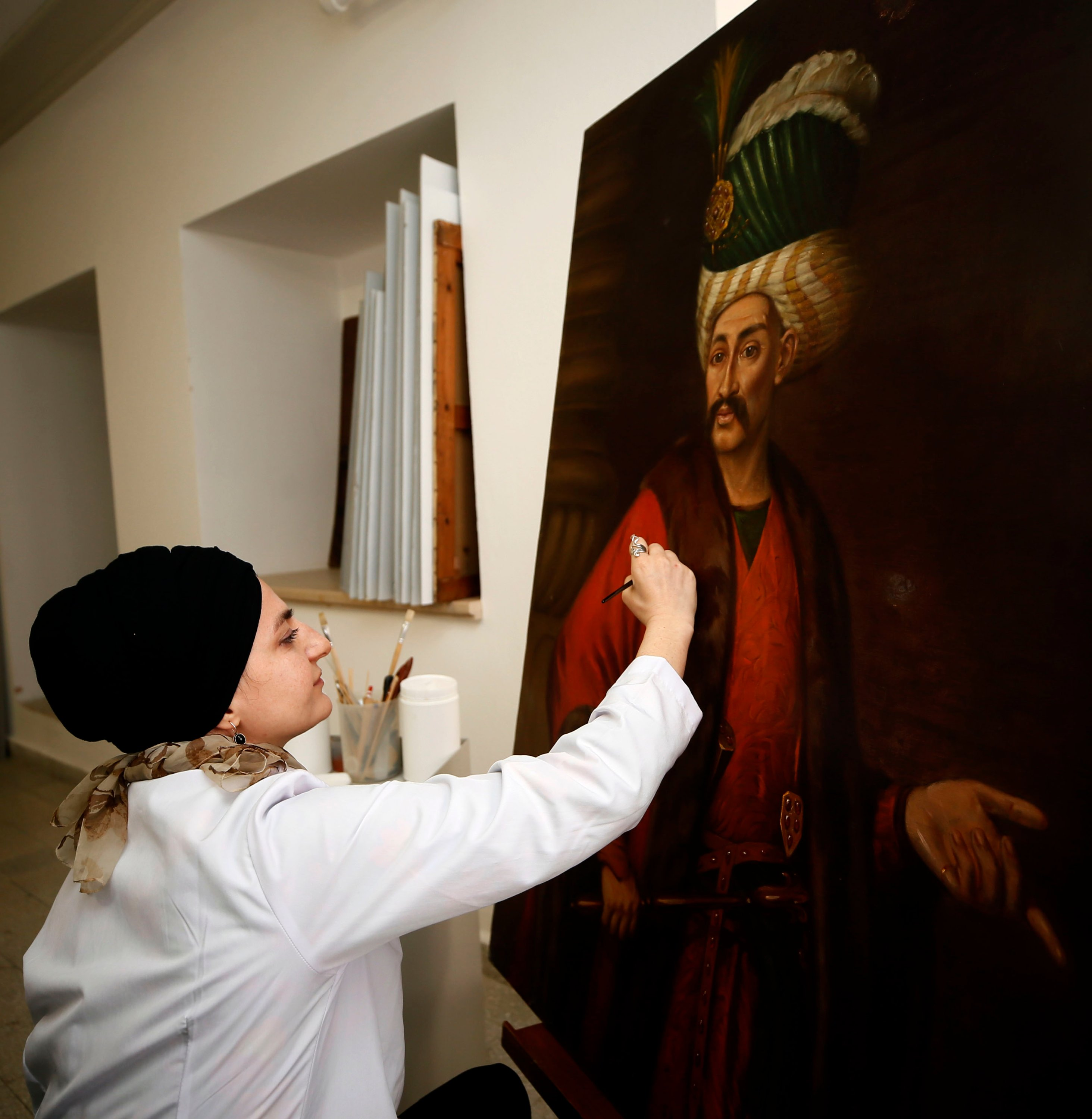The condition of the paintings is being tested as part of the restoration works. (AA Photo)