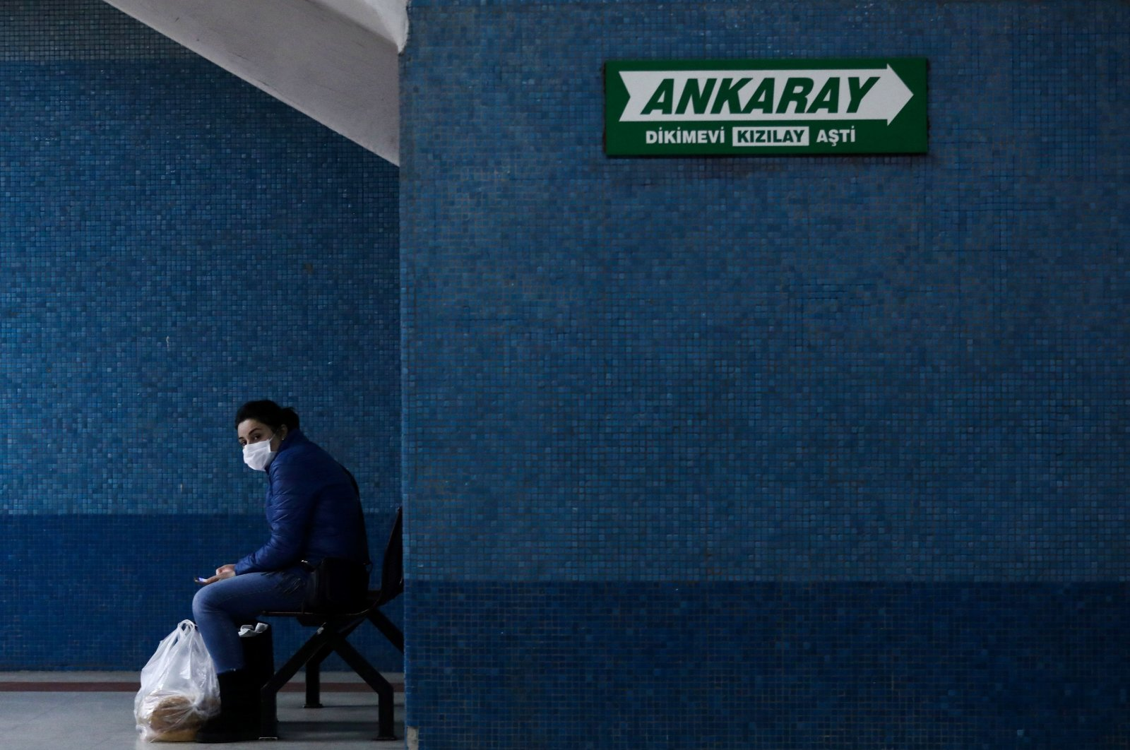 A woman wearing a face mask waits for the subway on the platform as the spread of the coronavirus continues in Ankara, April 16, 2020. (AFP Photo)