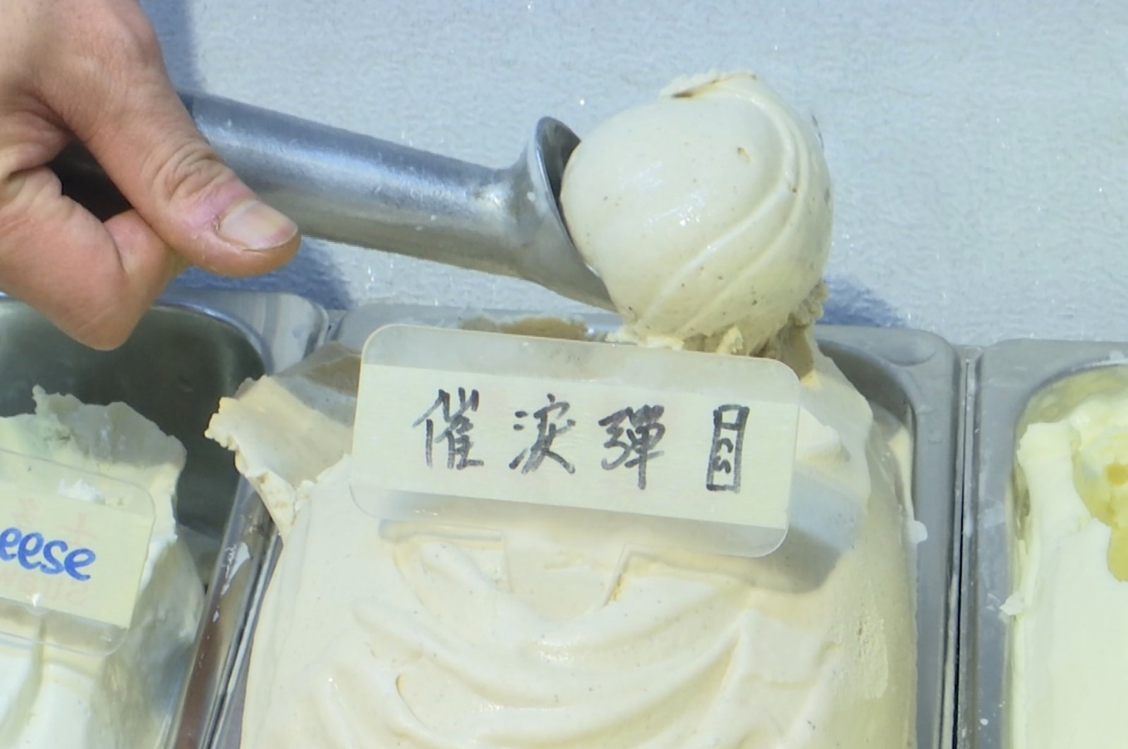 A scoop of tear gas flavored ice cream, in Hong Kong, May 4, 2020. (AP Photo)