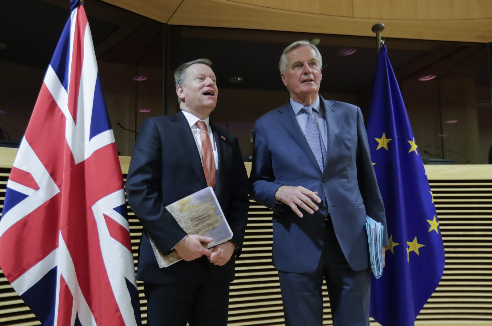 European Commission's Head of Task Force for Relations with the United Kingdom Michel Barnier, right, speaks with the British Prime Minister's Europe adviser David Frost at EU headquarters, Brussels, March 2, 2020. (AP Photo)