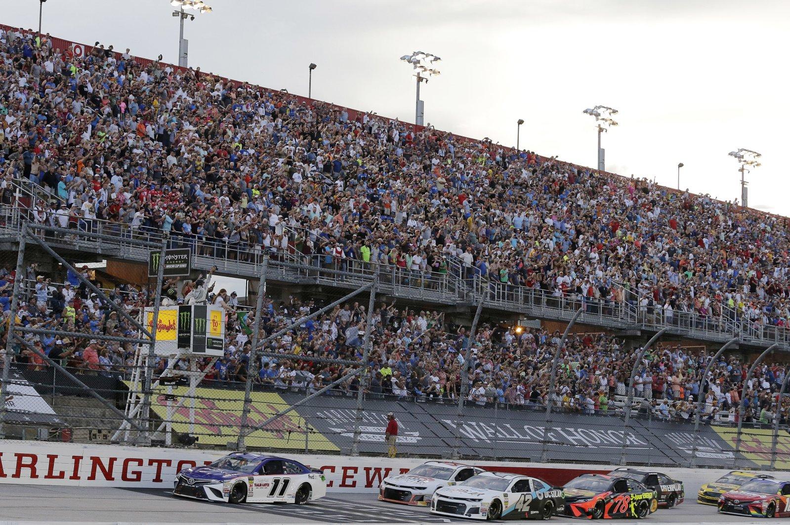 Denny Hamlin (11) leads the pack to start the NASCAR Cup Series auto race at Darlington Raceway in Darlington, U.S., Sept. 2, 2018. (AP Photo)