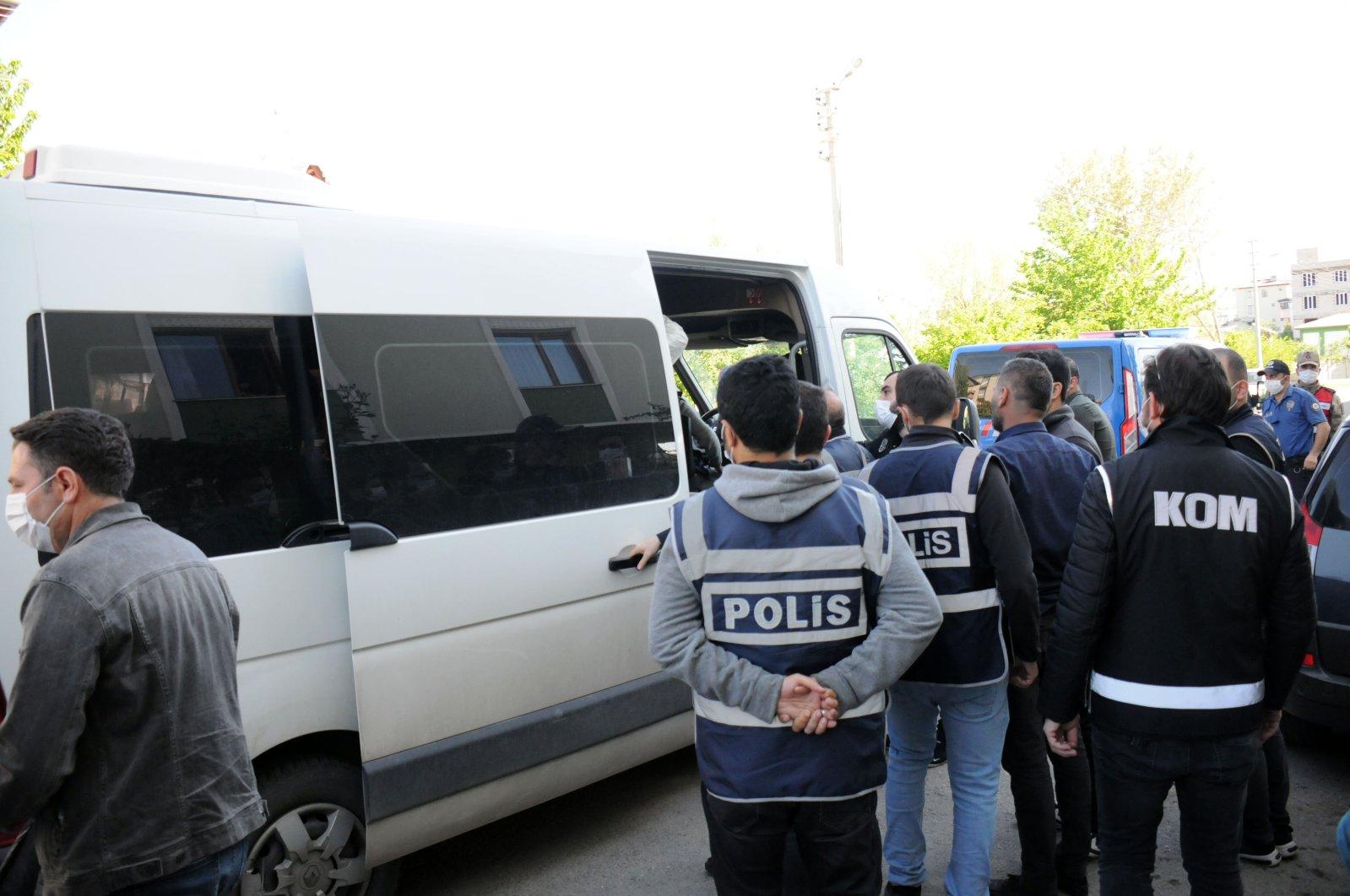 Police officers arrest the mayor of Iğdır as part of a terror probe, May 15, 2020. (AA)