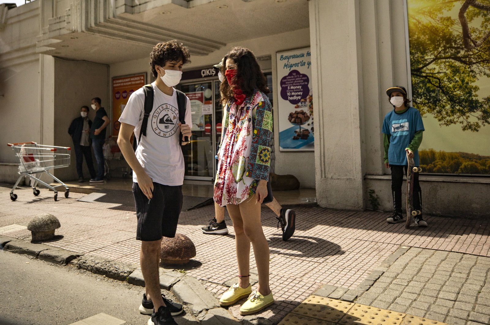 Two teenagers enjoy a day outside after youth ages 15 to 20 were allowed to go out for a limited time as part of eased coronavirus restrictions, Istanbul, Turkey, May 15, 2020. (AA Photo)
