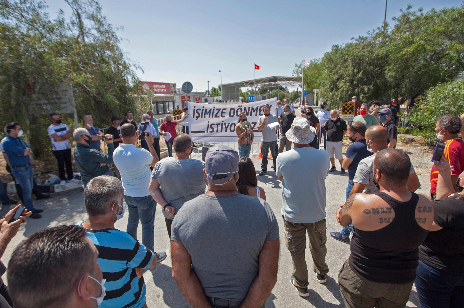 Turkish Cypriots living in the north are protesting the Greek Cypriot administration's closure of border gates as part of efforts to stop the spread of the coronavirus at the Ayios Dhometios crossing, May 15, 2020  (AFP Photo)