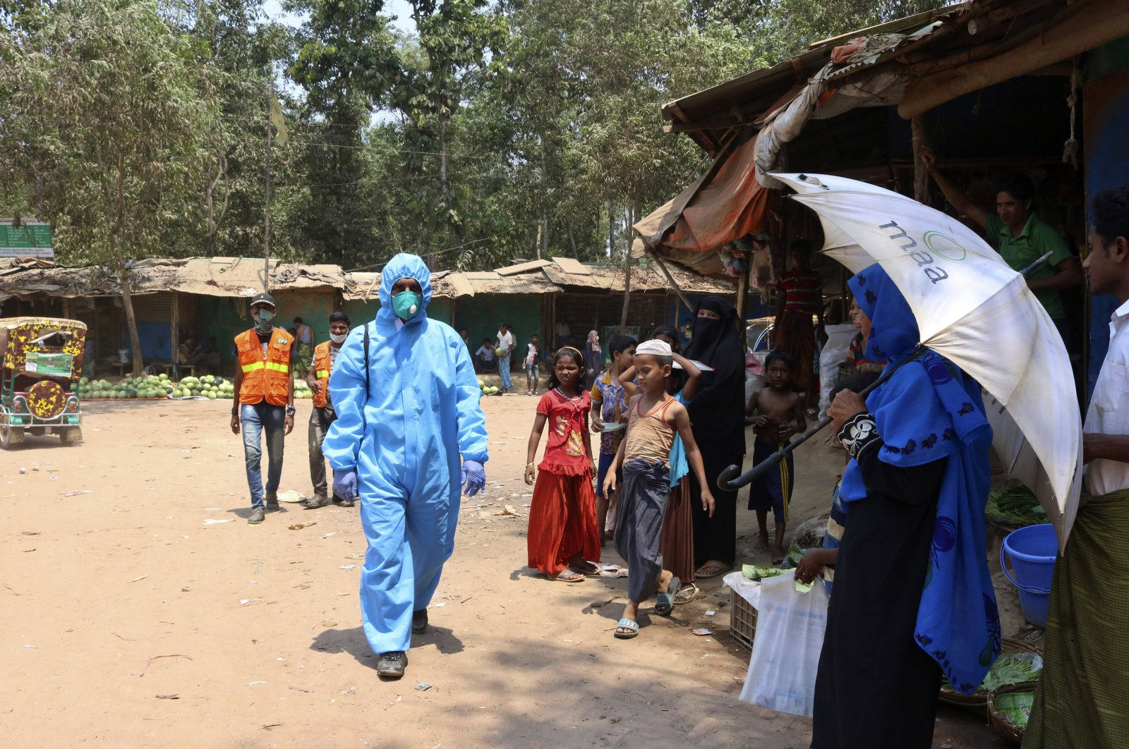 A health worker from an aid organization walks wearing a hazmat suit at the Kutupalong Rohingya refugee camp, Cox's Bazar, April 15, 2020. (AP Photo)