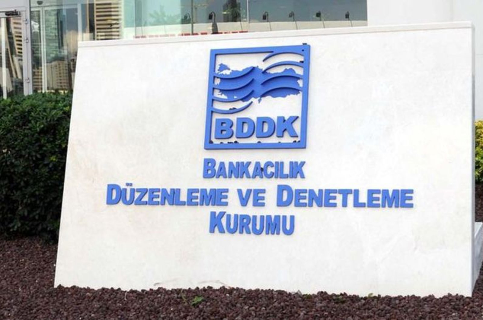 The Banking Regulation and Supervision Agency's (BDDK) logo is seen in front of its Istanbul headquarters.