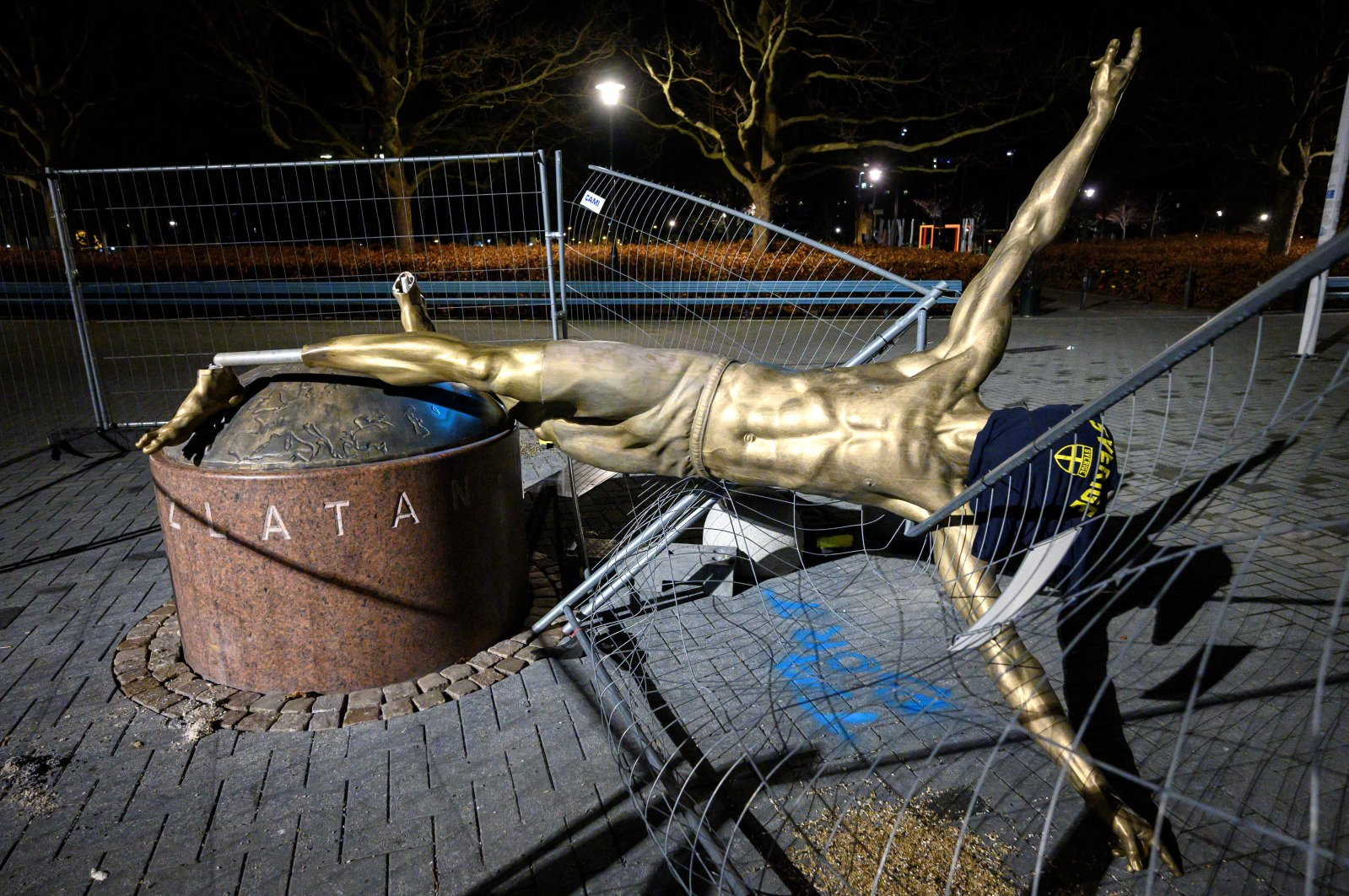 The statue of soccer player Zlatan Ibrahimovic is seen sawn down and destroyed, at the square next to a football arena in Malmo, Sweden, Jan. 5, 2020. (Reuters Photo)