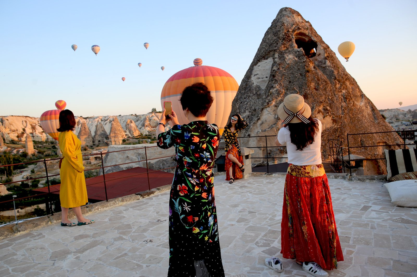 Tourists pose near fairy chimneys in Cappadocia, one of Turkey's well-known tourism spots, Cappadocia, Turkey, July 2019. (AA Photo)