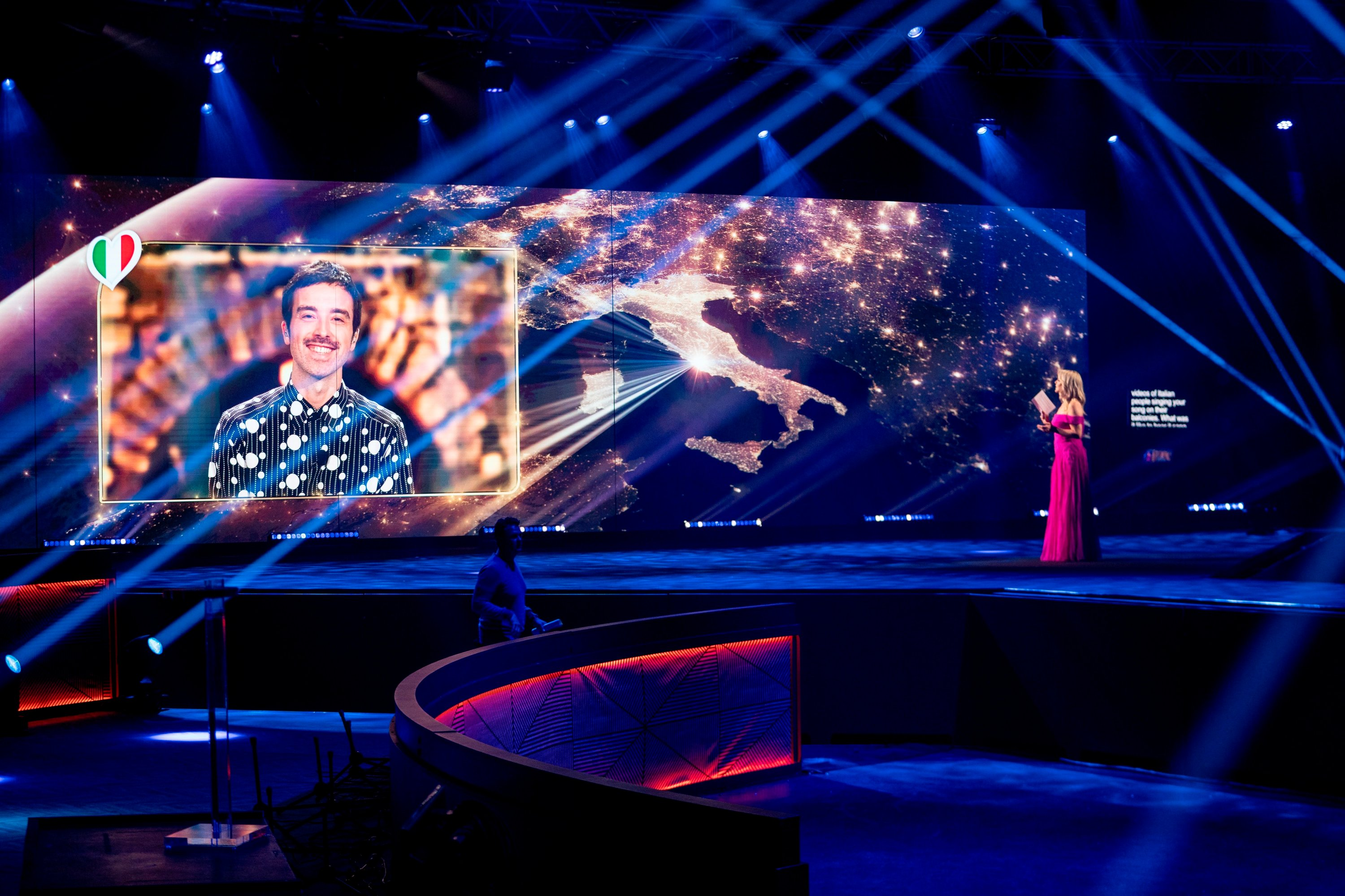 In this Saturday, May 16, 2020 image, host Chantal Janzen talks to Italy's Diodato during the Eurovision's Europe Shine A Light remote television show, in Hilversum, Netherlands. (AP Photo)