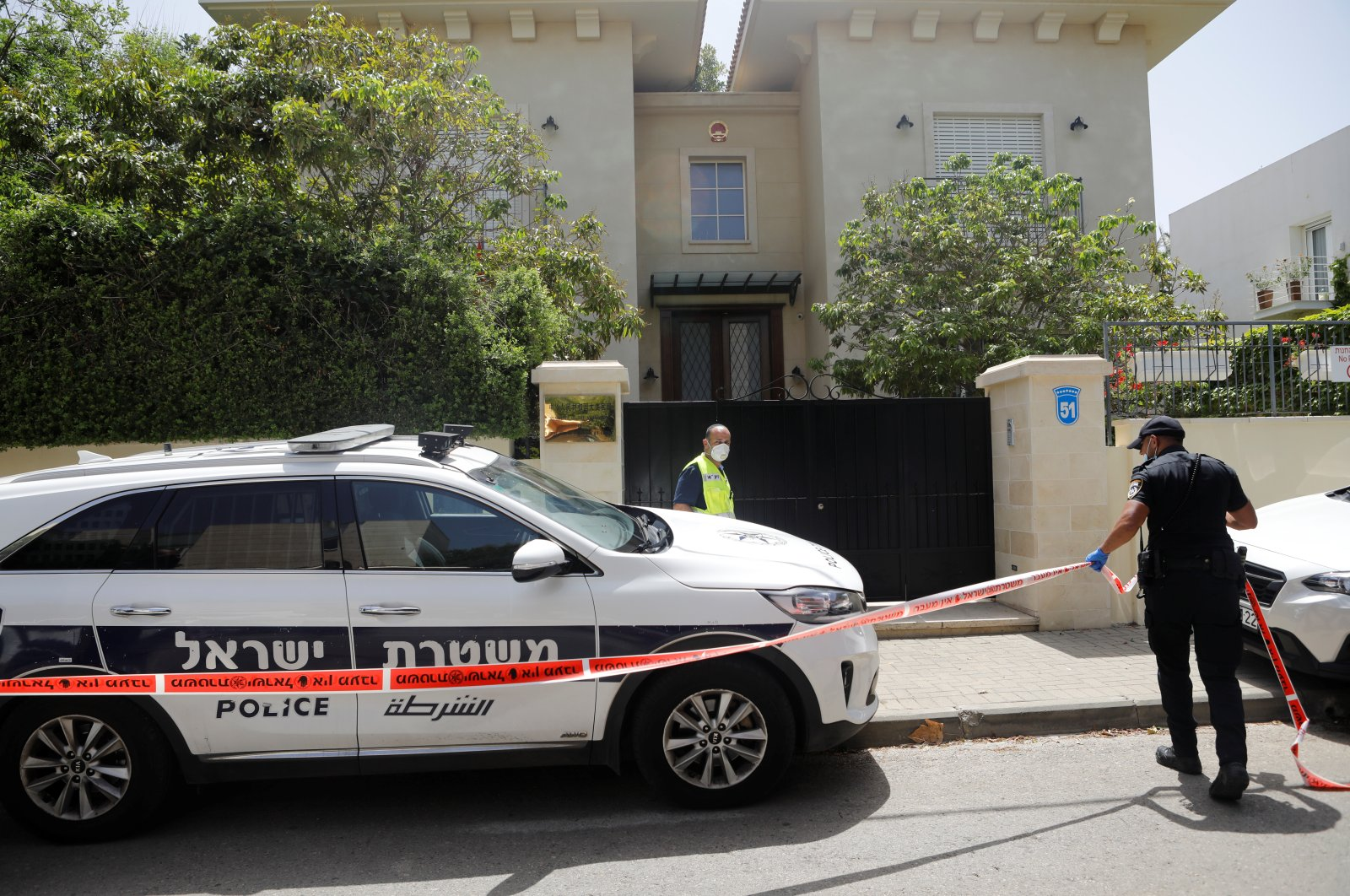 An Israeli policeman cordons off an area near the house of China's ambassador to Israel, Du Wei, in Herzliya, near Tel Aviv, Israel May 17, 2020. (Reuters Photo)