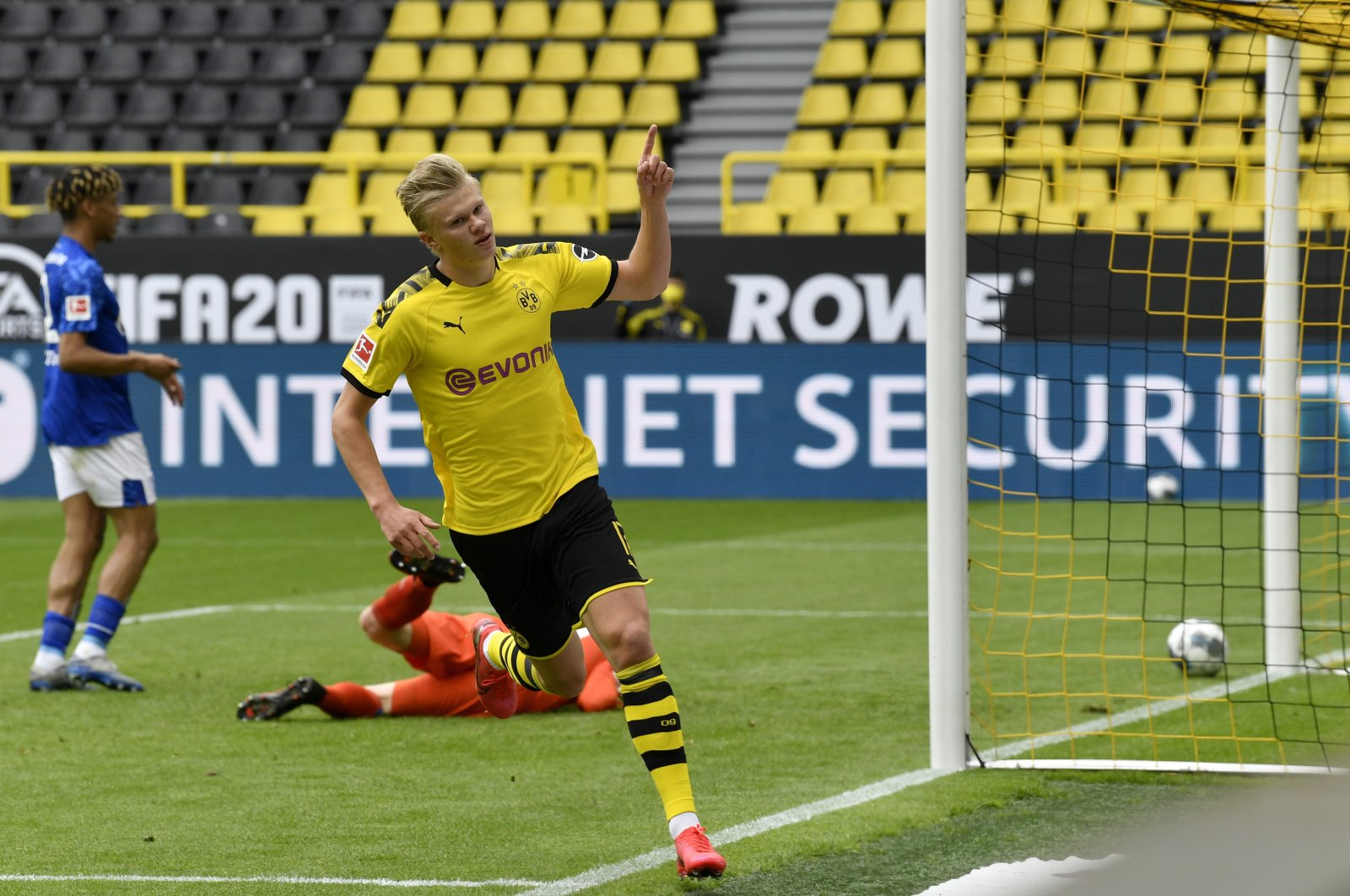 Dortmund's Erling Braut Haaland celebrates after scoring a goal during a Bundesliga match against Schalke 04, Dortmund, Germany, May 16, 2020. (EPA Photo)