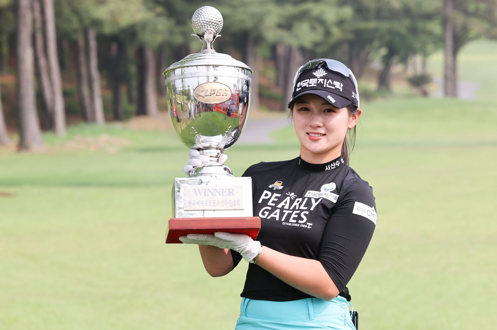 Park Hyun-kyung poses with the trophy after winning the final round of the KLPGA Championship golf tournament at Lakewood Country Club in Yangju, South Korea, May 17, 2020. (EPA Photo)