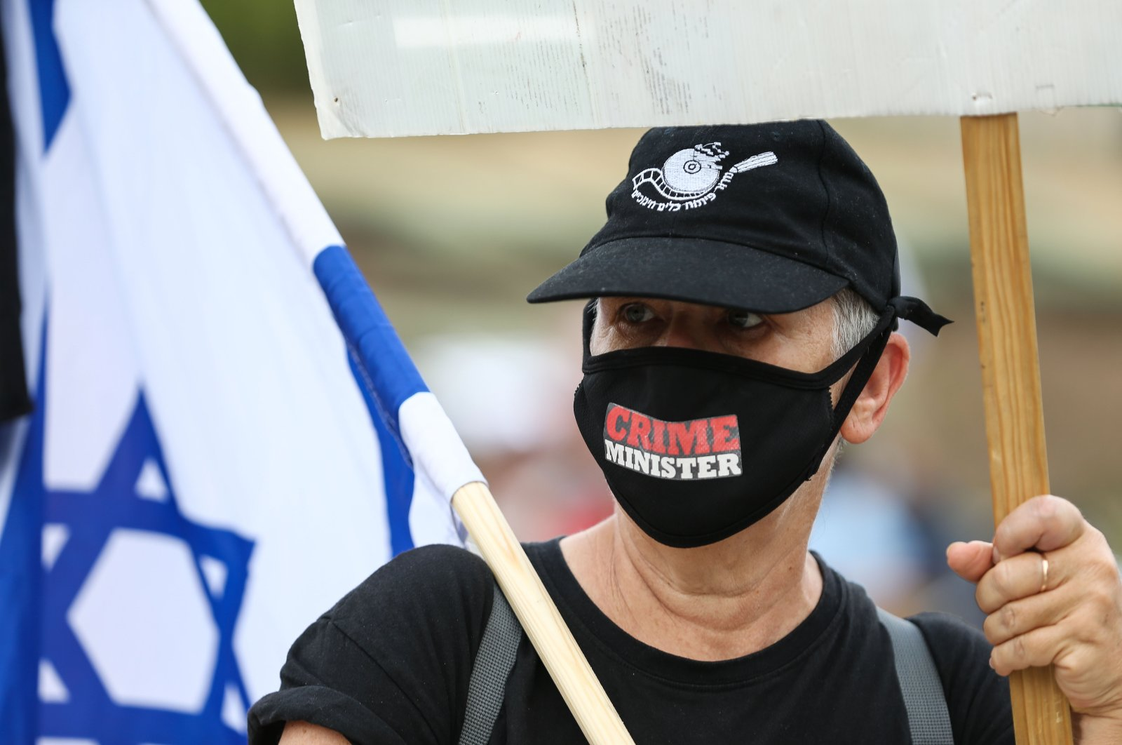 A protester in western Jeruselam is seen during a demonstration against the Netanyahu-Gantz unity government, May 14, 2020 (AA Photo)