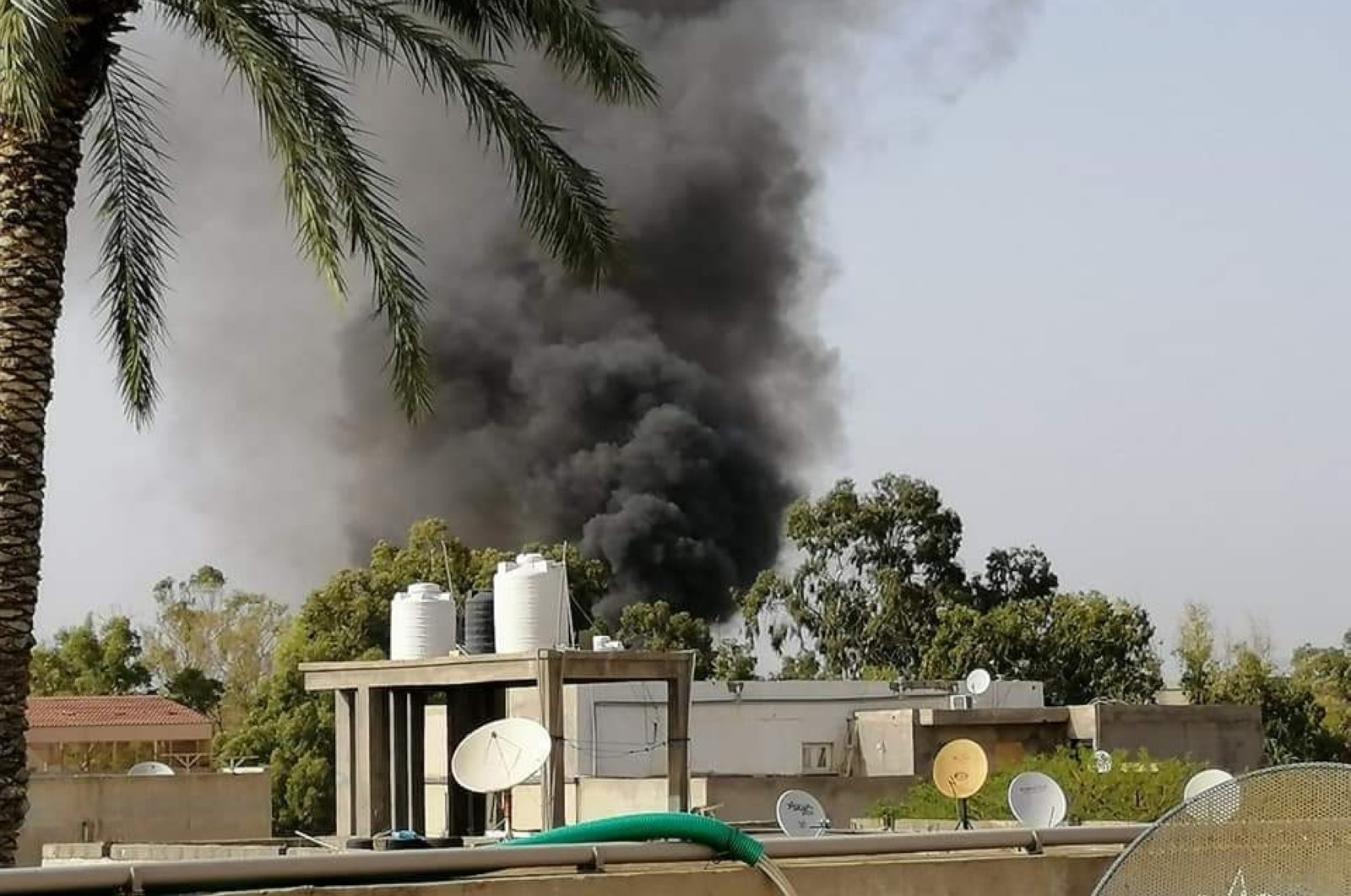 Seven people were killed in an attack by warlord Khalifa Haftar on a shelter for displaced people in Fornaj district, Tripoli, Libya, May 16, 2020. (IHA Photo)