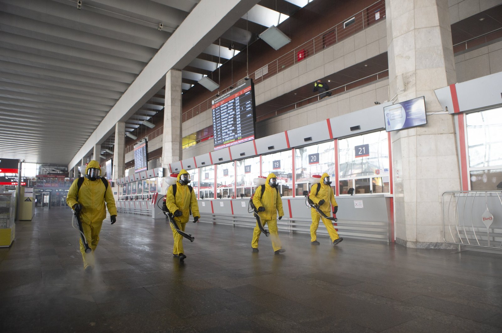 Employees of the Federal State Center for Special Risk Rescue Operations of Russia Emergency Situations disinfect a hall at the Kurskiy railway station in Moscow, Russia, Friday, May 15, 2020. (AP Photo)