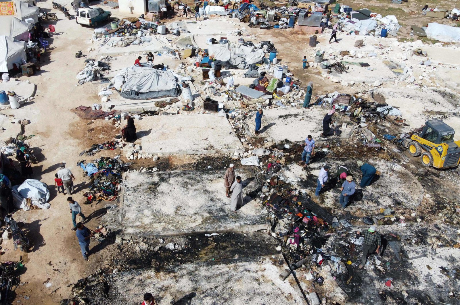 An aerial view shows charred tents after a fire that was reportedly caused by a cooking accident destroyed dozens of temporary shelters housing displaced Syrians, in the Deir Hassan camp for the displaced, in Idlib's northern countryside near the Turkish border, May 17, 2020. (AFP Photo)