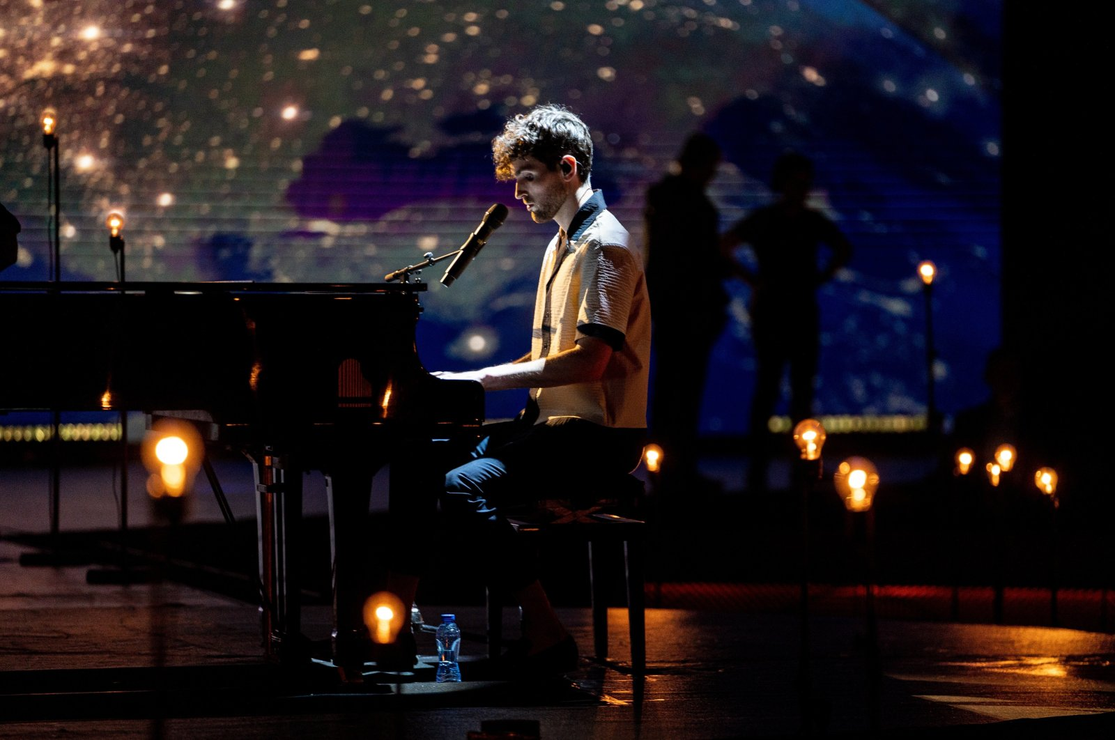 In this Saturday, May 16, 2020 image,winner of the 2019 Eurovision Song Contest Duncan Laurence performs during the Eurovision's Europe Shine A Light remote television show, in Hilversum, Netherlands. (AP Photo)