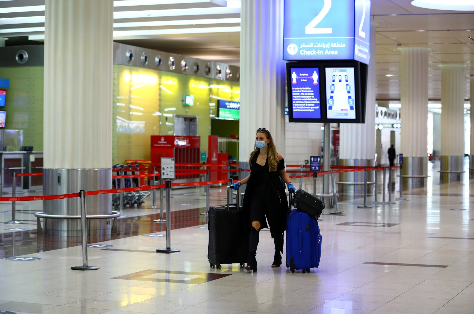 A passenger walks at Dubai International Airport, as Emirates Airlines resumed limited outbound passenger flights amid the outbreak of the coronavirus disease (COVID-19) in Dubai, UAE April 27, 2020. (Reuters Photo)