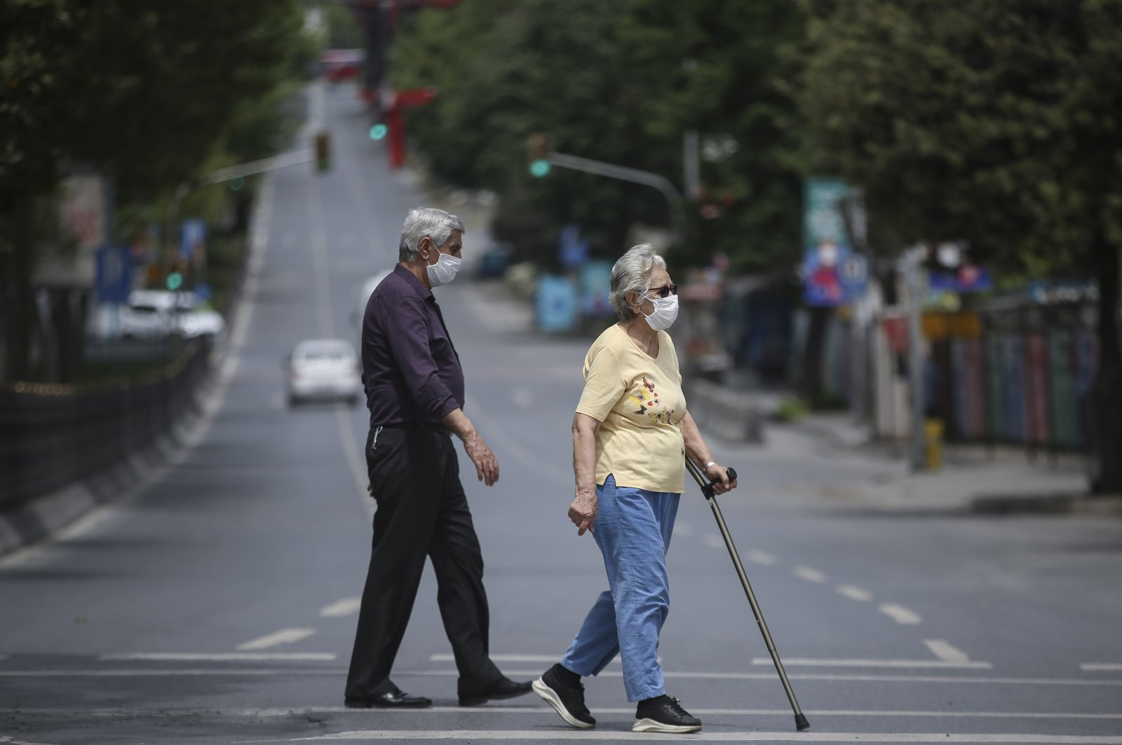 An elderly man and woman walk on the street in Istanbul's Beşiktaş district, Turkey, May 17, 2020. (AA Photo)