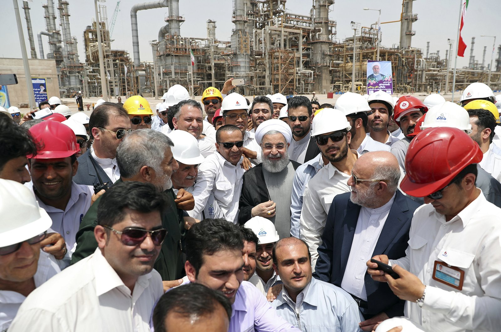 Iranian President Hassan Rouhani (C) inaugurates the Persian Gulf Star Refinery in Bandar Abbas, Iran, April 30, 2017. (Iranian Presidency Office via AP Photo)