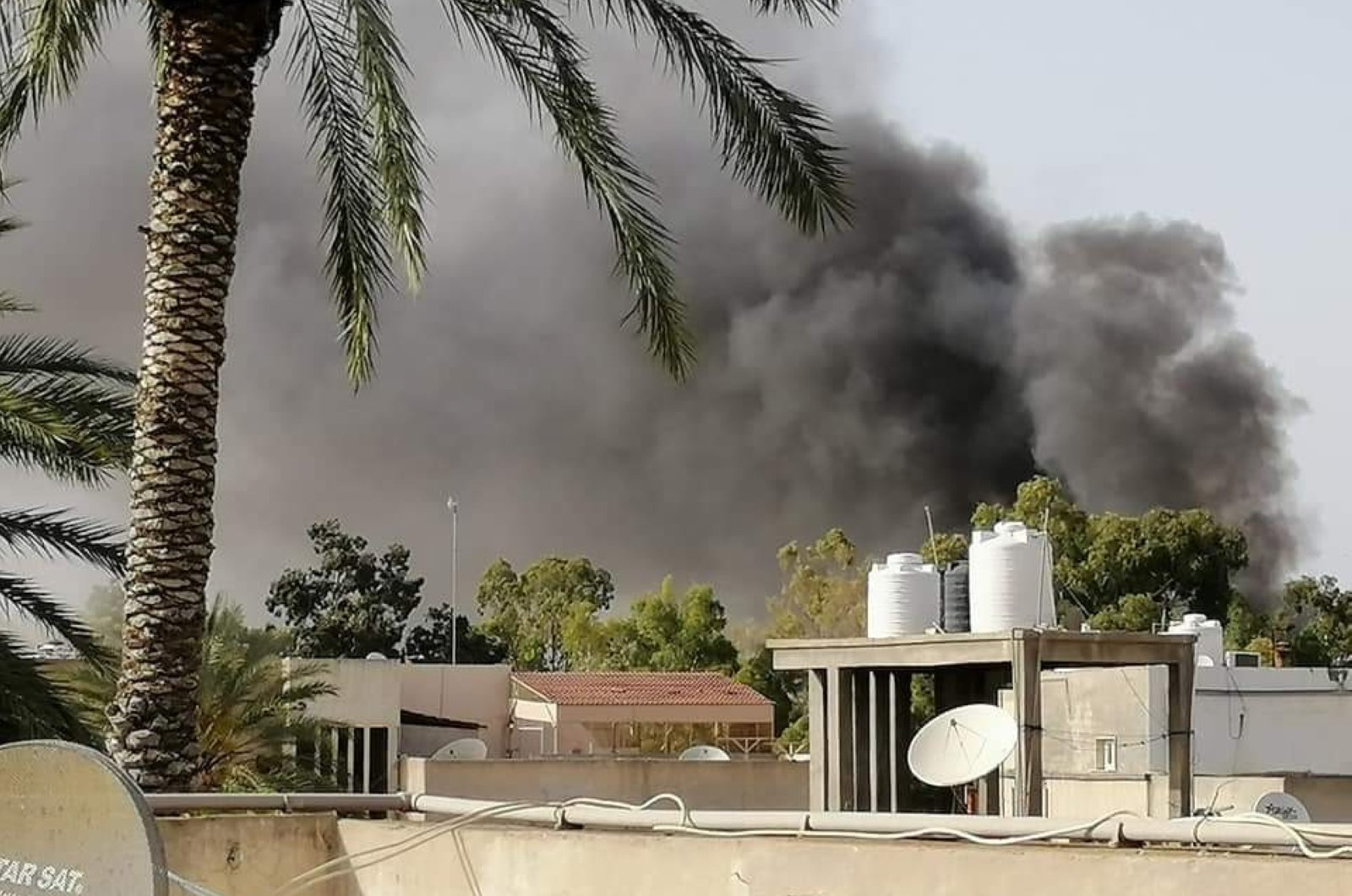 Smoke rises from the site of a bombing in Tripoli, Libya, May 16, 2020. (IHA Photo)