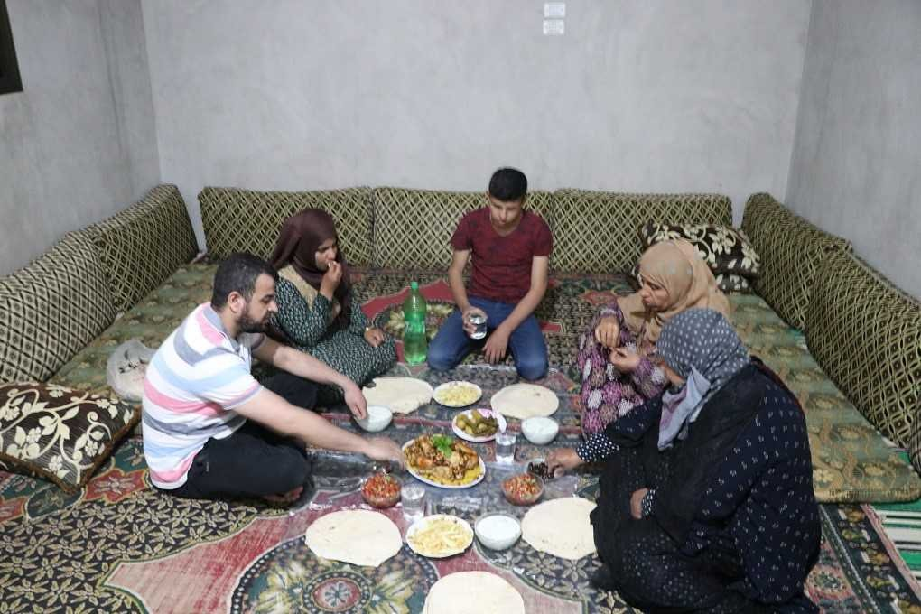 A Syrian family has their iftar meal with food delivered by Turkish aid agencies, Ras al-Ayn, May 18, 2020. (AA)