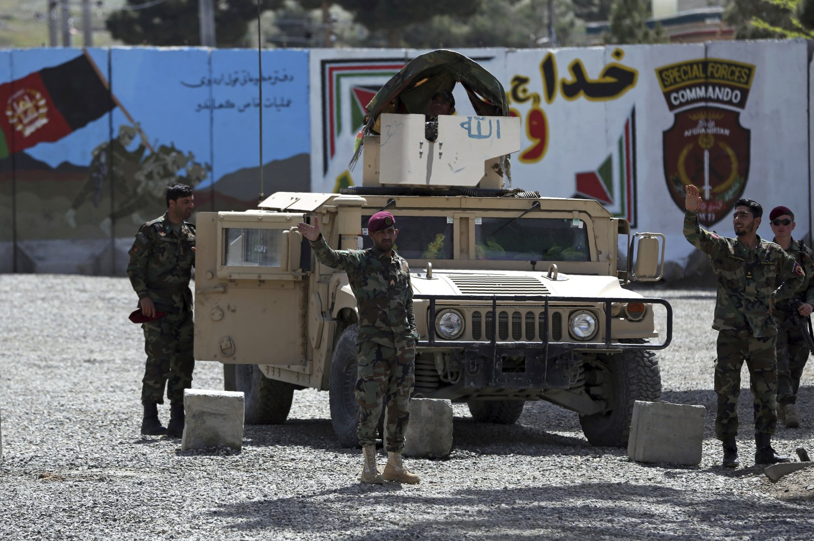 Afghan special forces stand guard near the site of a suicide bomber attack on the outskirts of Kabul, Afghanistan, Wednesday, April 29, 2020. (AP Photo)