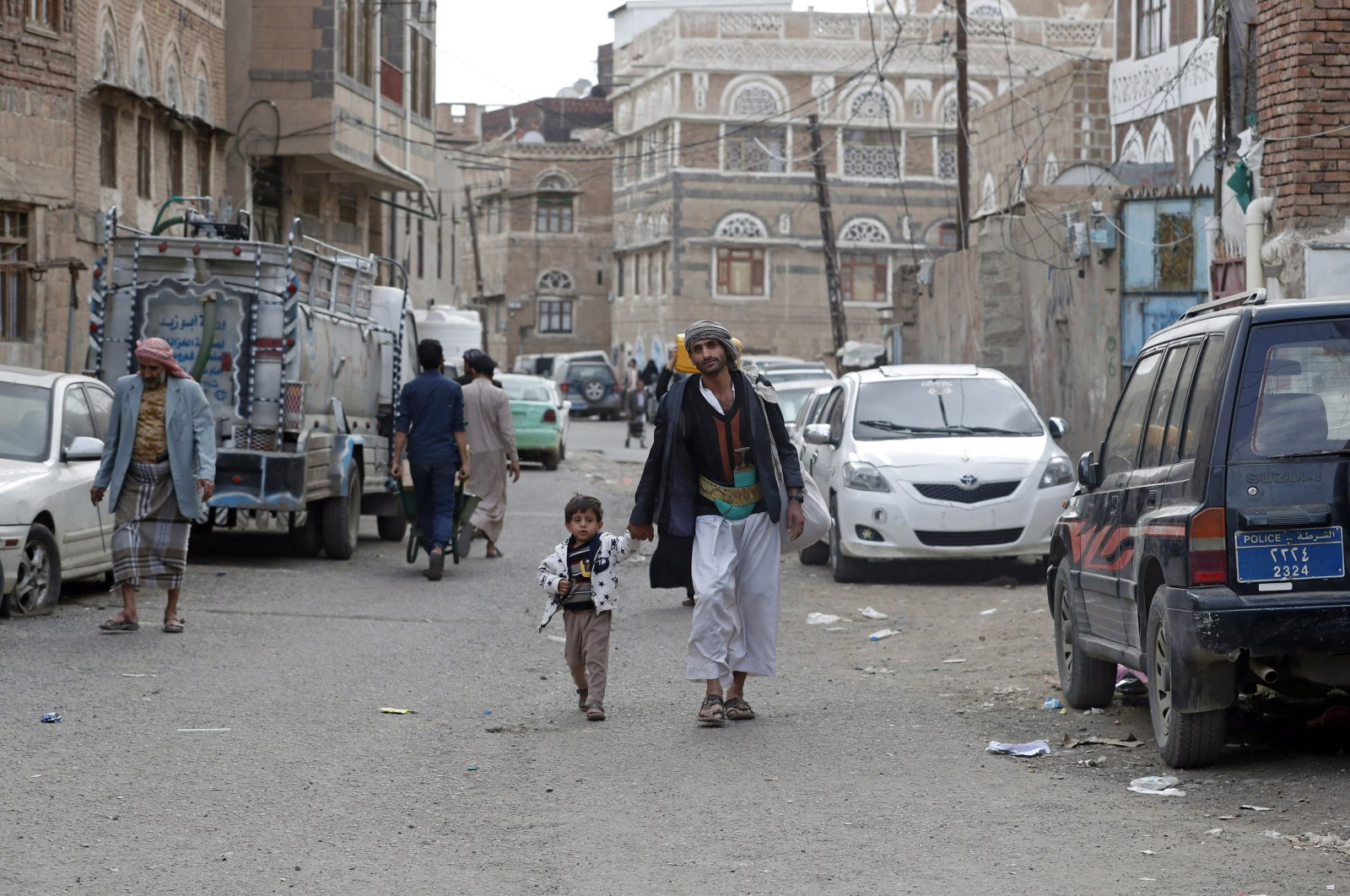 Yemenis walk through a street amid the ongoing coronavirus COVID-19 pandemic, Sanaa, May 15, 2020. (EPA Photo)