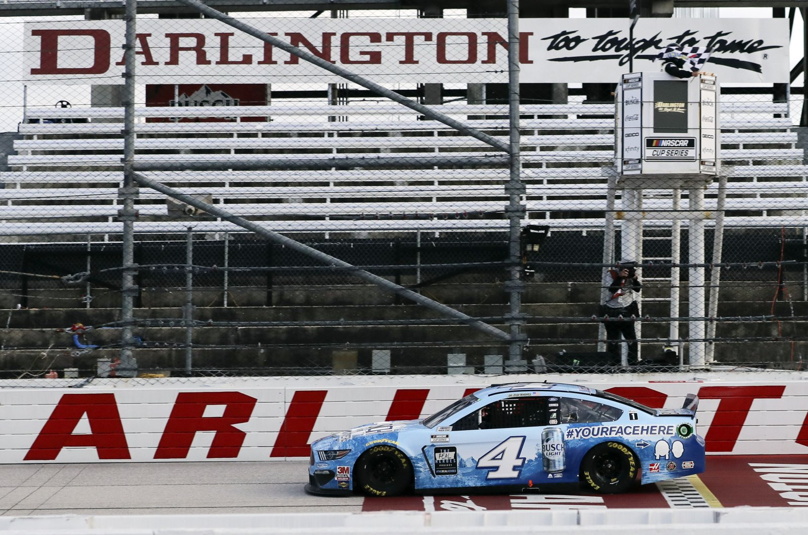 Kevin Harvick (4) crosses the finish line to win the NASCAR Cup Series auto race, Darlington, S.C., U.S., May 17, 2020. (AP Photo)