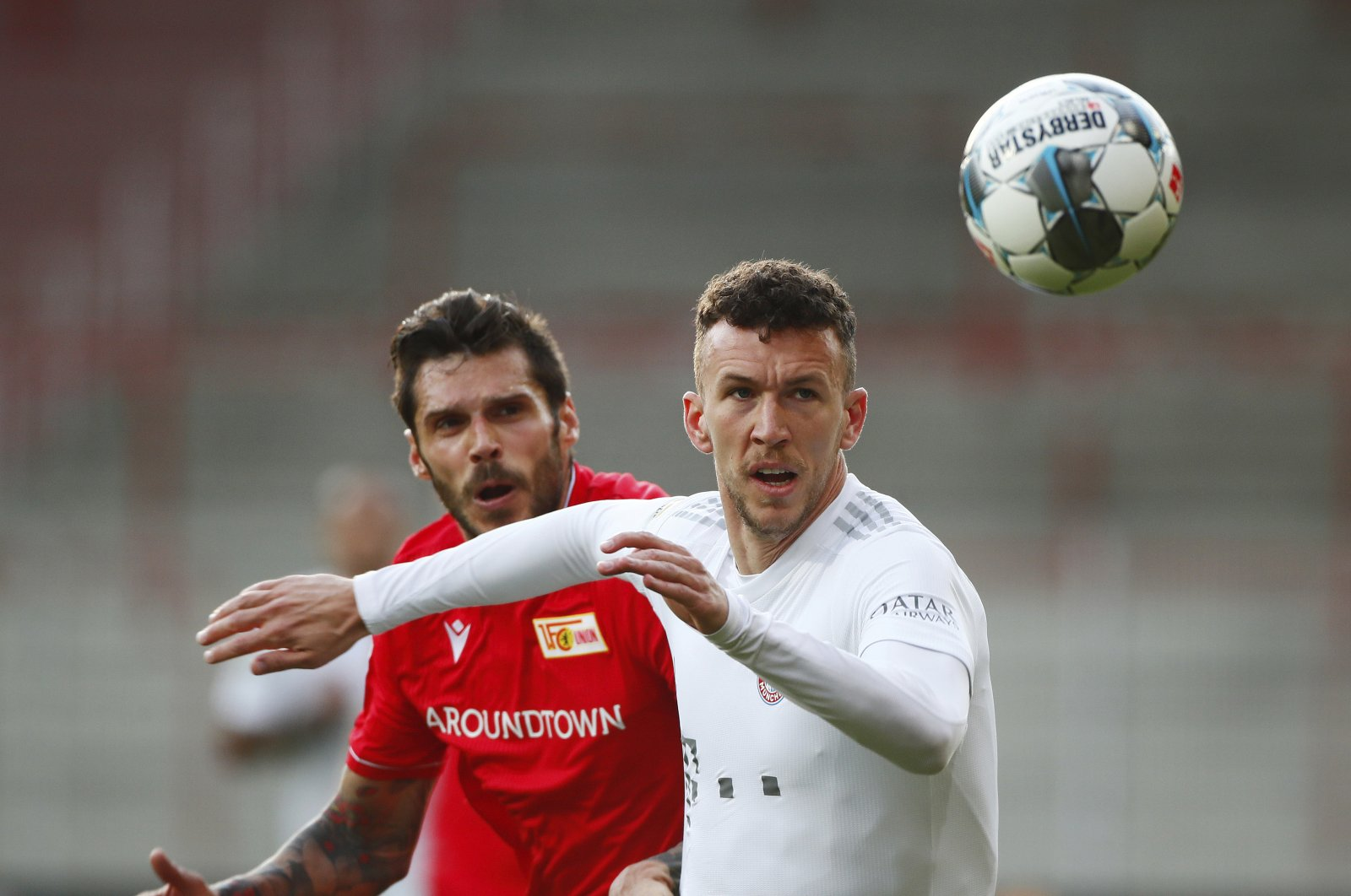 Bayern Munich's Ivan Perisic in action with Union Berlin's Christopher Trimmel during the match in Berlin, Germany, May 17, 2020. (AP Photo)