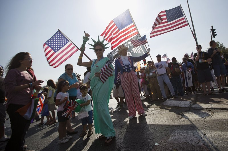 Evangelical Christians from various countries wave American flags, Jerusalem, Oct. 1, 2015. (AP Photo)