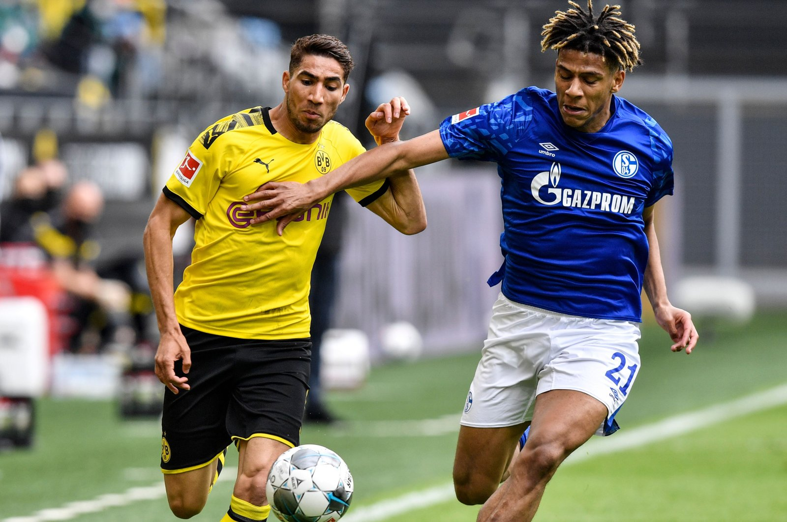 Dortmund's Achraf Hakimi vies for the ball with Schalke's Jean-Clair Todibo during a Bundesliga match in Dortmund, Germany, May 16, 2020. (AFP Photo)