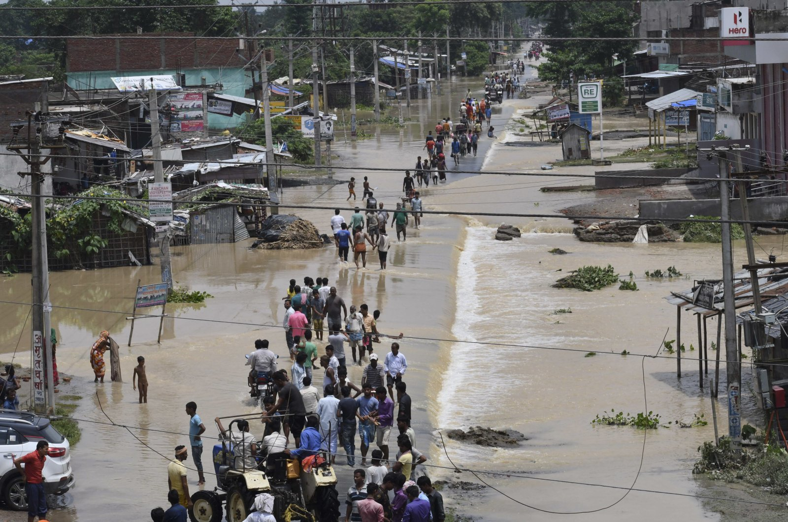 Flood-affected villagers move to safer places in the Narpatganj Block of the Araria district, Bihar, India, Aug. 14, 2017. (AP Photo)