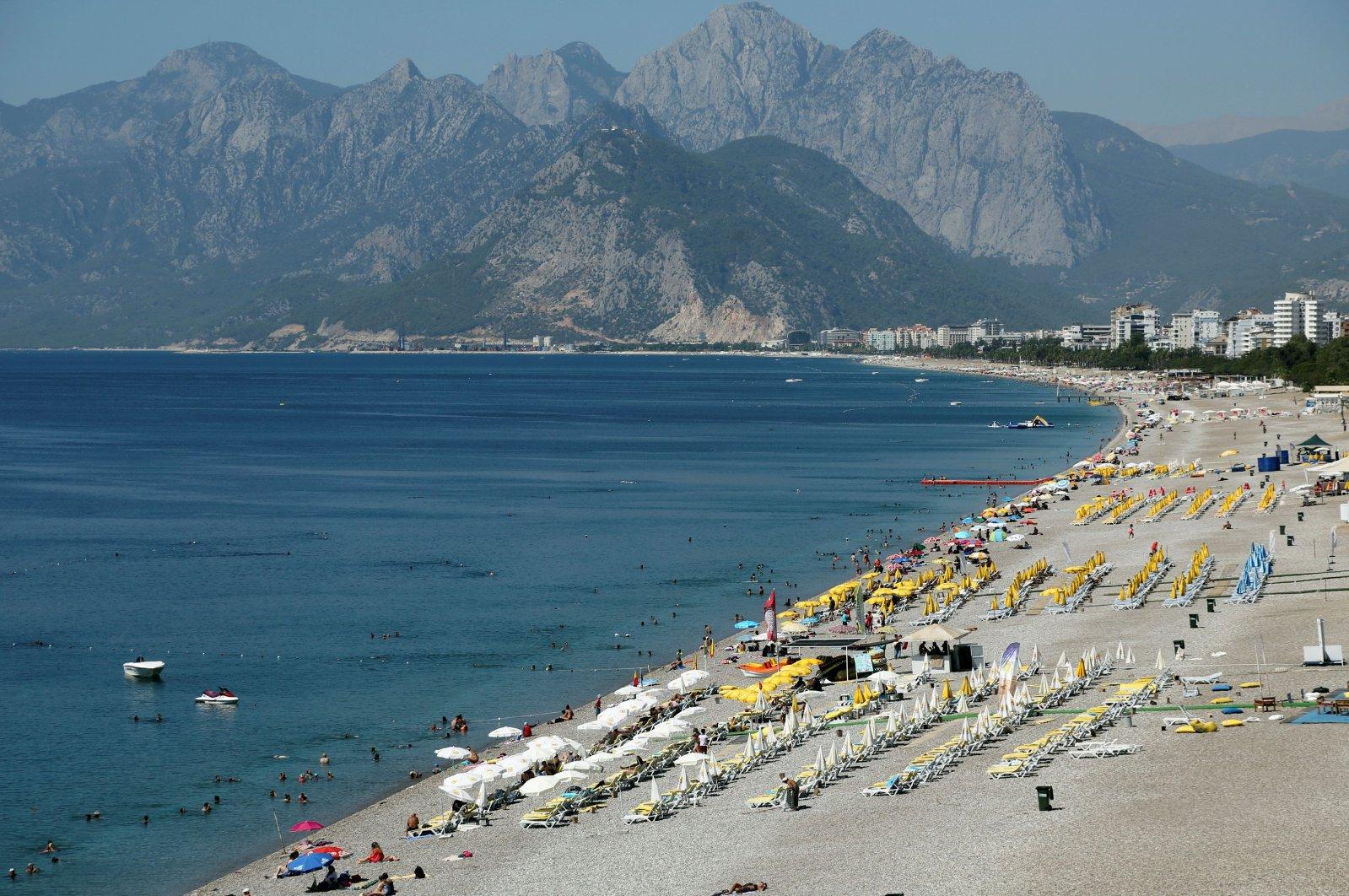 Tourists enjoy a beach in the Mediterranean resort city of Antalya, a popular destination for tourists, Turkey, July 25, 2016. (Reuters Photo)