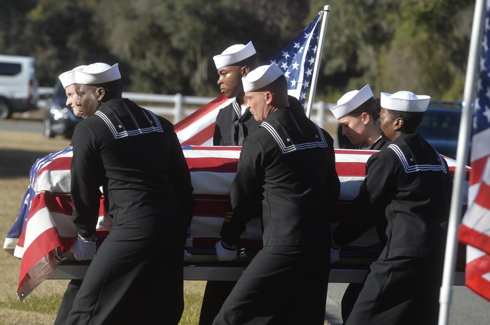 Sailors carry the casket of Cameron Walters at Oak Hill Cemetery in Richmond Hill, Ga. Walters was one of the three Navy sailors killed in a Saudi gunman's attack at Pensacola Naval Air Station in Florida on Dec. 6. (AP Photo)