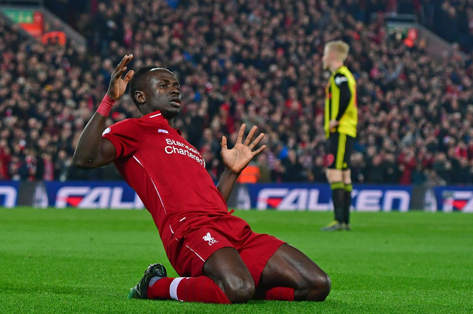 In this file photo taken on February 27, 2019 Liverpool's Senegalese striker Sadio Mane celebrates after scoring the opening goal of the English Premier League football match between Liverpool and Watford at Anfield in Liverpool, northwest England. (AFP Photo)