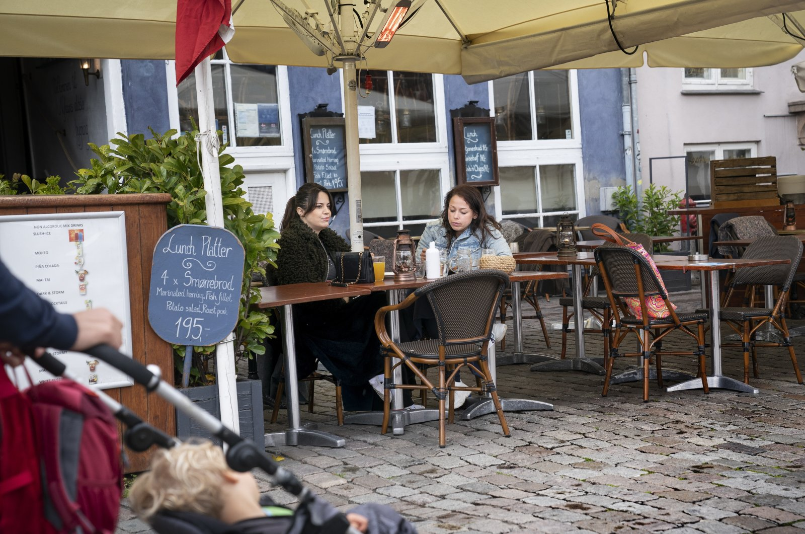 People sit at a restaurant in Copenhagen, Denmark, May 18, 2020. (EPA Photo)