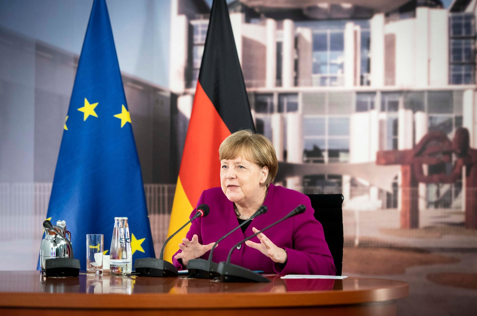A handout picture shows German Chancellor Angela Merkel talking to French President Emmanuel Macron during a joint video conference in the chancellery in Berlin, May 18, 2020. (REUTERS Photo)