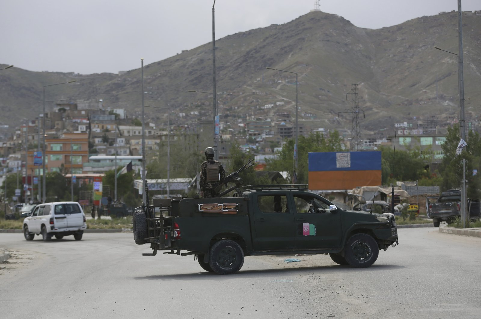 Afghan security forces inspect the site of a bomb explosion in Kabul, Afghanistan, Monday, May 18, 2020. (AP Photo)