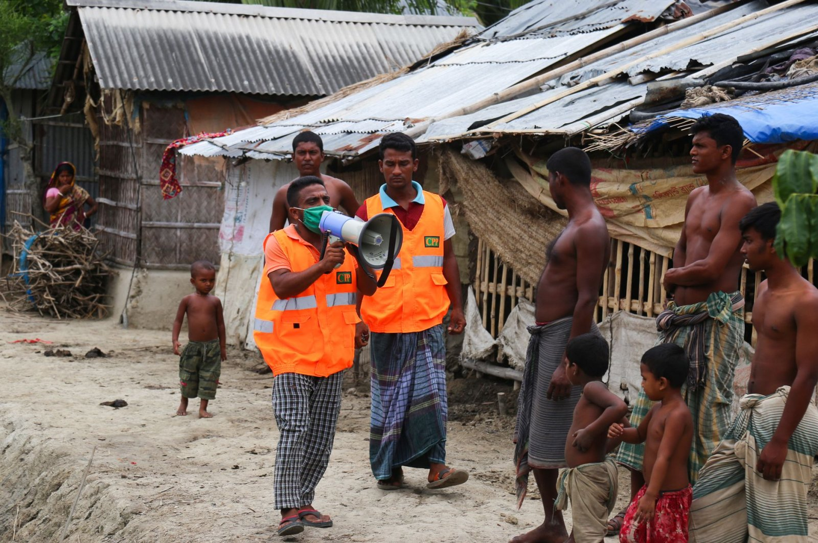 A Cyclone Preparedness Programme (CPP) volunteer uses a megaphone to urge residents to evacuate to shelters ahead of the expected landfall of Cyclone Amphan in Khulna, Bangladesh, May 19, 2020. (AFP Photo)