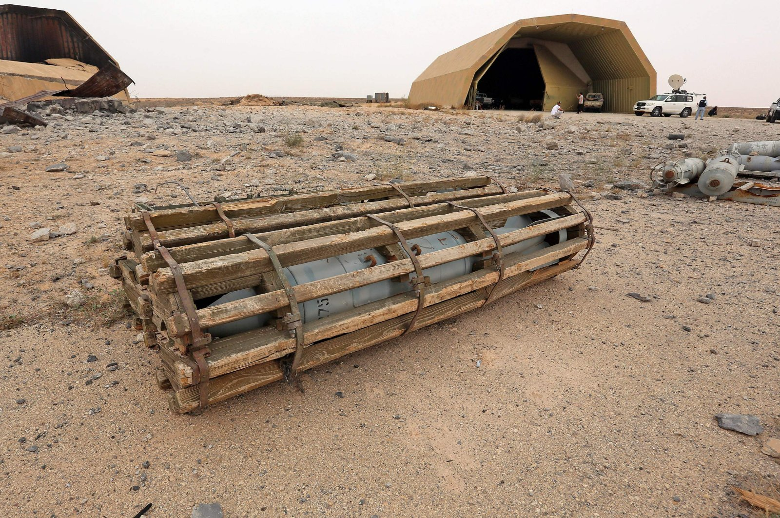 A view of a discarded aircraft-mounted explosive outside a hangar at Al-Watiya air base, southwest of the capital Tripoli, after the strategic location was seized by forces loyal to Libya's U.N.-recognized Government of National Accord (GNA), Libya, May 18, 2020. (AFP Photo)