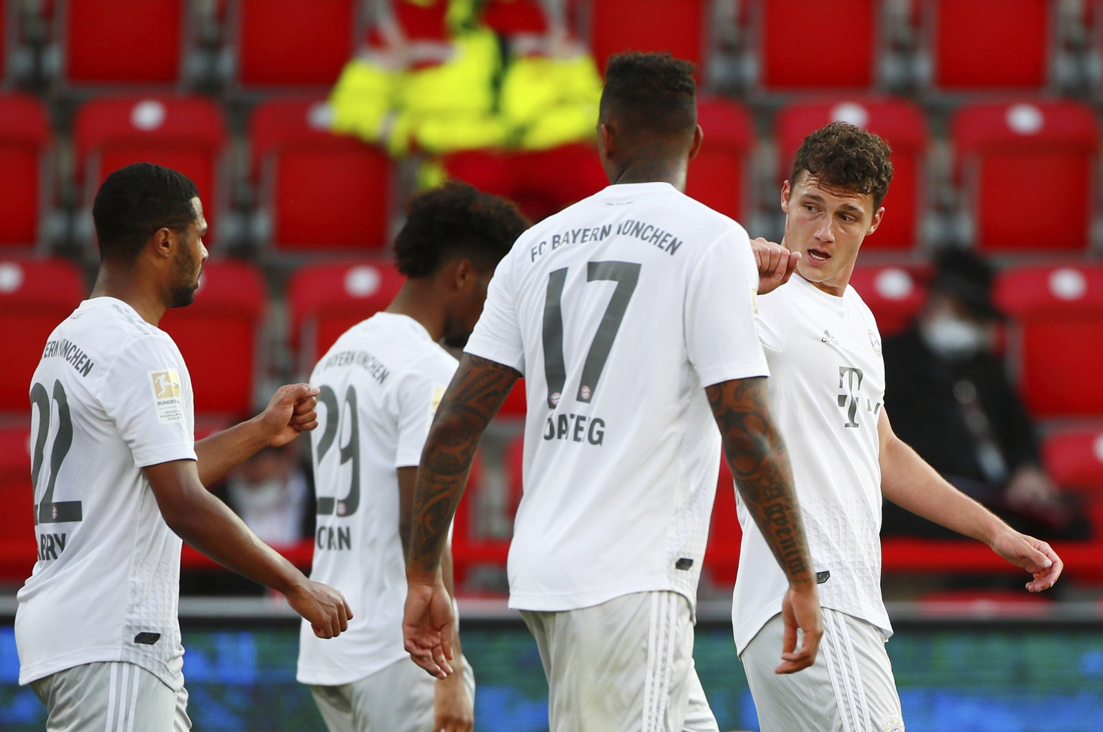Bayern Munich's Benjamin Pavard (R) celebrates his side's second goal during the German Bundesliga against Union Berlin, Berlin, Germany, Sunday, May 17, 2020. (AP Photo)