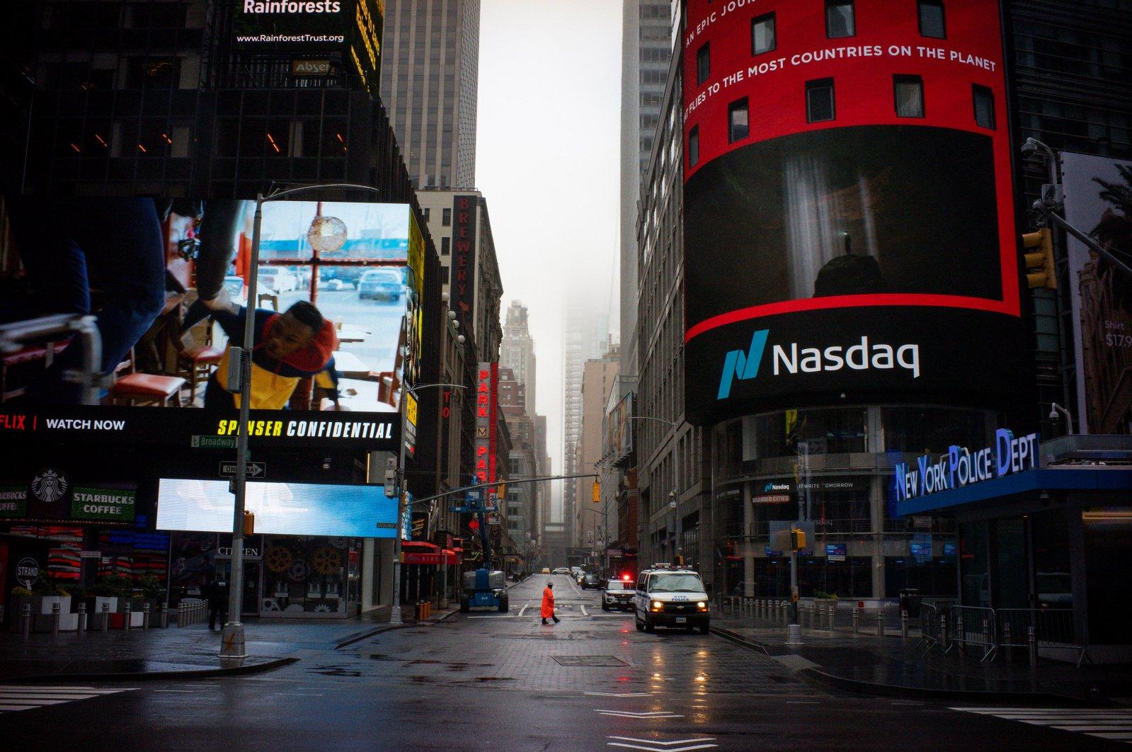 A man walks near Nasdaq MarketSite in an empty Times Square during the coronavirus outbreak in New York City, U.S., March 29, 2020. (Reuters Photo)