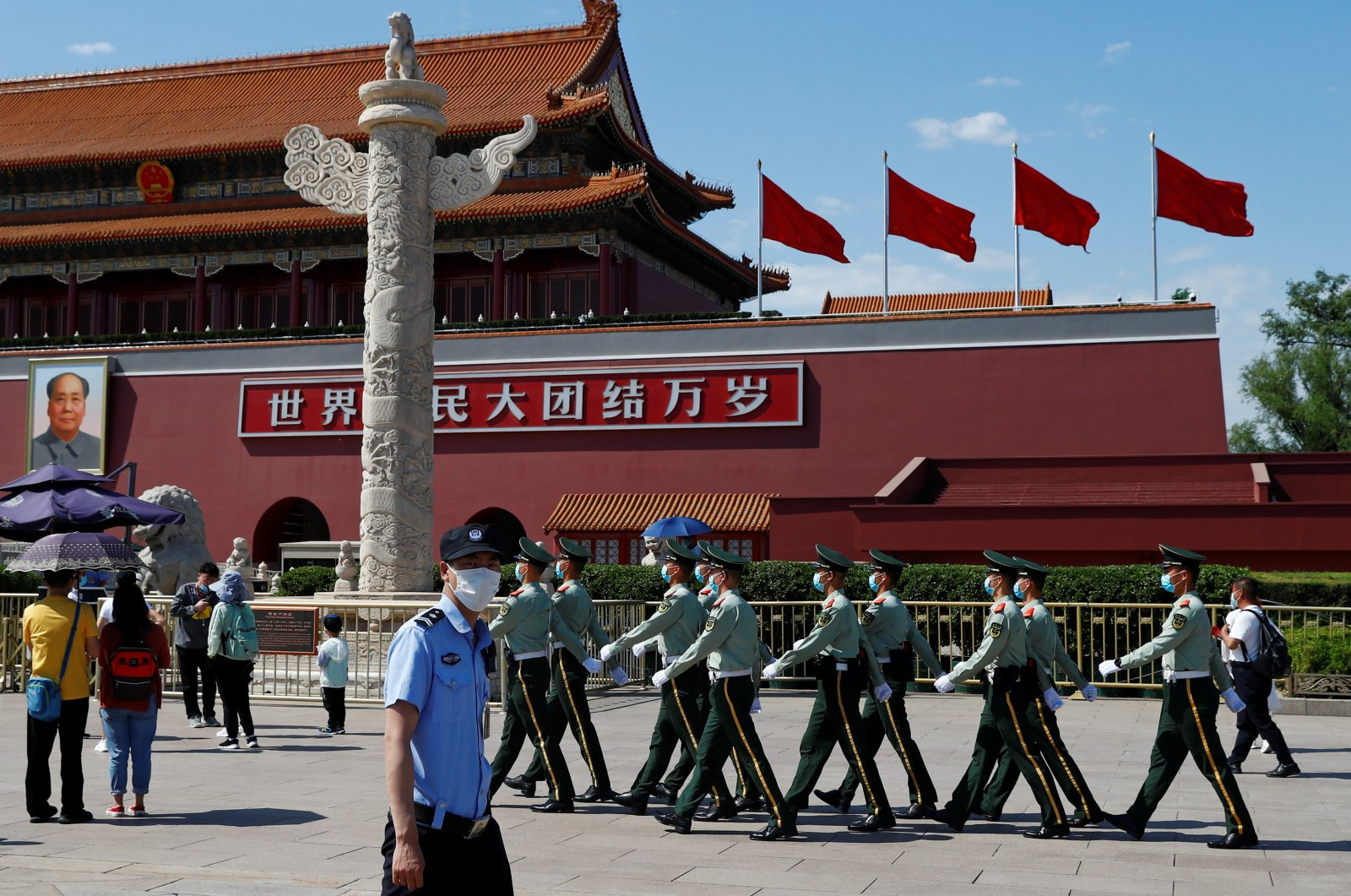Paramilitary police officers walk in formation in Tiananmen Square near the Great Hall of the People, the venue of the upcoming People's National Congress (NPC) in Beijing, China, May 19, 2020. (Reuters Photo)