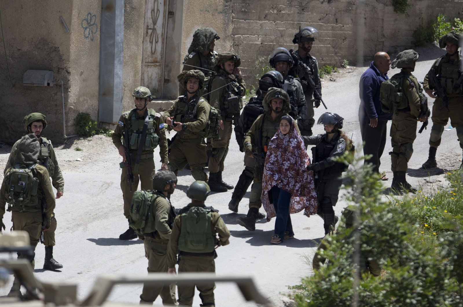 Israeli soldiers arrest a Palestinian in the village of Ya'bad near the occupied West Bank city of Jenin, Palestine, May 12, 2020. (AP Photo)