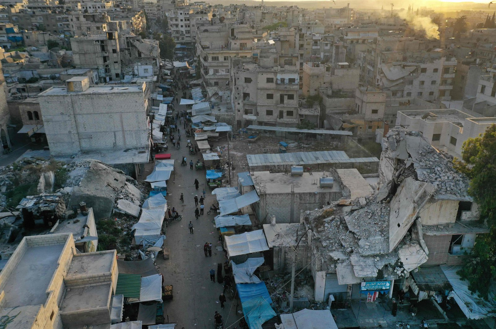 This picture taken on May 15, 2020 shows an aerial view of a market street (with heavily damaged buildings nearby) in Ariha in the southern countryside of Syria's Idlib province. (AFP Photo)