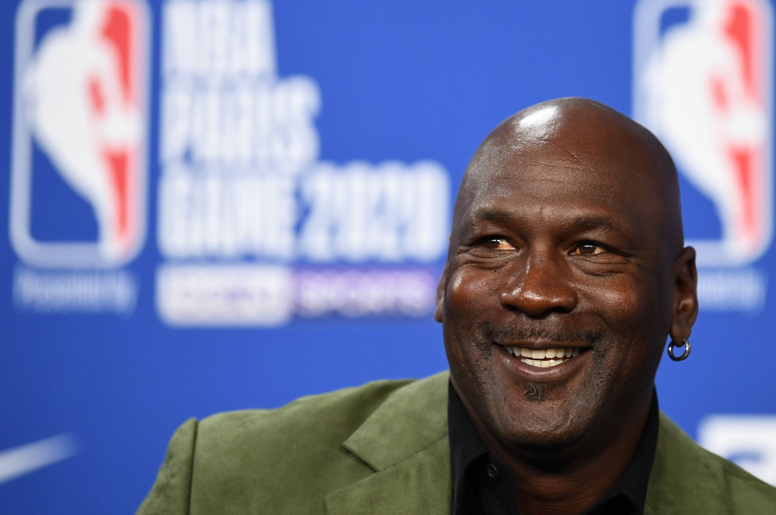 In this file photo former NBA star and owner of Charlotte Hornets team Michael Jordan looks on as he addresses a press conference ahead of the NBA basketball match between Milwaukee Bucks and Charlotte Hornets at The AccorHotels Arena in Paris on January 24, 2020. (AFP Photo)